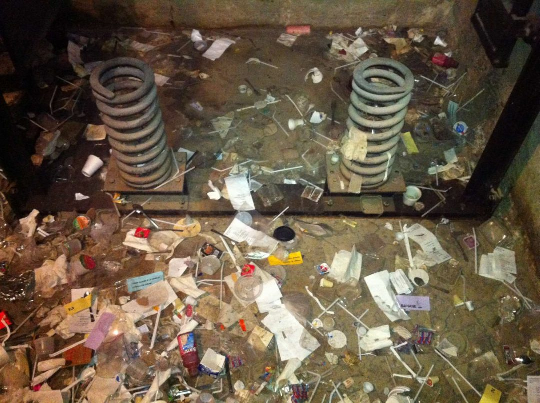 Elevator pit filled with trash – fire hazard