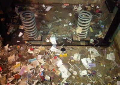 Elevator pit filled with trash – fire hazard